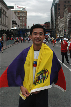 Alfonso Lam of Venezuela wrapped himself with his native country's flag.