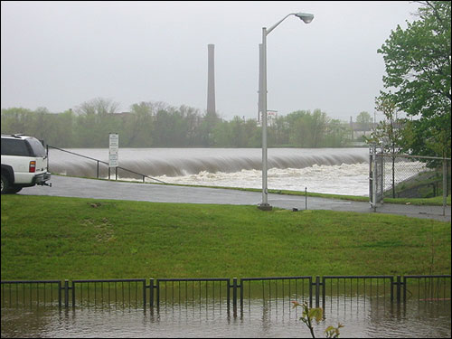 The Great Dam in Lawrence is rendered invisible by the rushing water in this David Desruisseau photo.