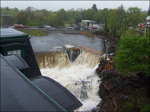 Aaron Clark of Methuen shot this photo of the surging Spicket River from a nearby roof.