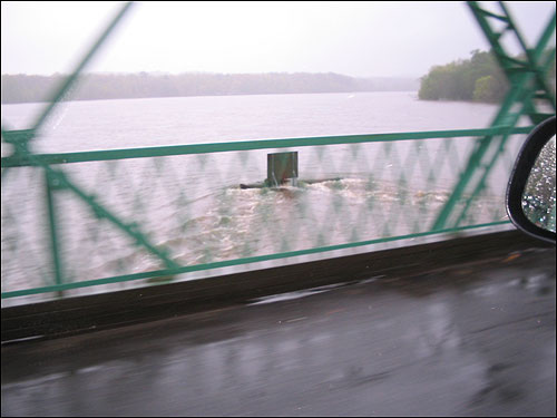 The Merrimack River surges around a sign in this photo, taken by Thomas Fallon from the West Village Bridge in West Newbury.