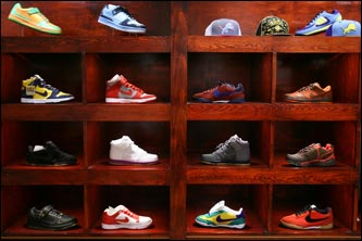 Inside Boston's new sneaker boutique Bodega, a posh store that sells limited edition sneakers ranging in price from $80 to $2000. Bodega joins sneaker boutique Laced, which opened this winter, and Concepts, which turns 10 this year, as suppliers to a subculture that communicates through word-of-mouth, Internet sites, specialty magazines, and sneaker parties. Sneakerheads -- a few are willing to call themselves addicts -- collect limited edition (read expensive) lines of sneakers, getting up at the crack of dawn or camping out overnight to get the latest Air Jordan retro or Nike SB. The culture is so ardent that the owners of Bodega didn't bother to put a sign on the front of the store. Word spreads, and the collectors follow.