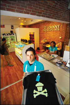 Johnny Earle, owner of Johnny Cupcakes, in his Newbury Street store.