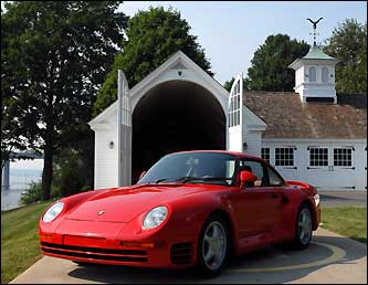This 1987 red Porsche 959 Supercar has all-wheel drive, a suspension that goes up and down and can achieve 205 mph.