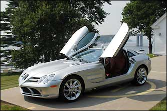 Herb Chambers purchased his first car dealership in 1985 in New London, Conn. Today, Chambers owns 31 dealerships, and he's about to buy three more, all within 50 miles of Boston. Shown here is his 2006 silver Mercedes McLaren SLR, with a top speed of 205 mph.