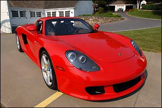 His 2006 red Porsche GT has a t-top, rear engine, and 10 cylinders.