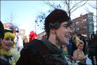 Hasty Pudding club members walk among the crowd at the parade.