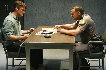 Alex (Nathan Fillion) is interrogated by Officer Poole (Michael Bowen) in the new Fox series 'Drive'