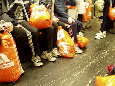 Orange bags on the Red Line.