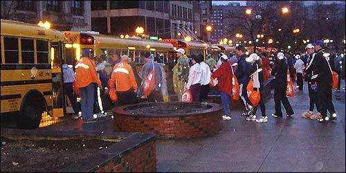 Runners lined up at Boston Common to board the buses to Hopkinton.