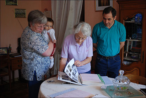 Some of the French Mormons whom Romney met still remember him fondly. They have followed his career on television, and in some cases have stayed in touch. In this photo, shot earlier this year in Bordeaux, Suzanne Farel, the accident survivor, looks at pictures of Romney with her daughter, Annie Guerrero, and her daughter's husband, Manuel Guerrero.