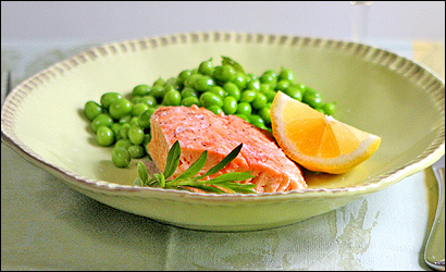 Poached salmon with fresh peas and mint