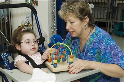 Franciscan Hospital for Children's Peggy Chase, RN, and her charge Amanda are exploring the wonders of childhood.