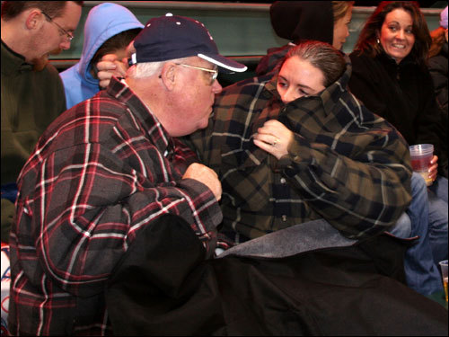 Tom Russell, from Rochester, N.Y., broke out the heavyweight flannel as he watched the game with his daughter Tricia Daigle, from Scarborough, Maine.