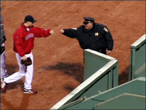 Red Sox closer Jonathan Papelbon did the knuckle-knock with Boston Police Officer Billy Dunn as he entered the bullpen. The Sox closer would not be called upon in the 10-3 Boston win.