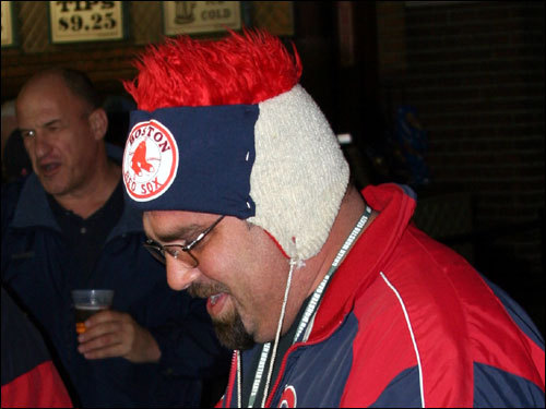 Matt Lambo, from Watertown, said his red hair hat made him easy to spot in the crowd, and it keeps his head warm.