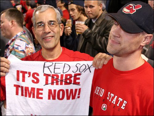 John Vieira, with his reversed Tribe Tim towell gladly irks Indians fan John Kobs in the bleachers before the start of Game 6.