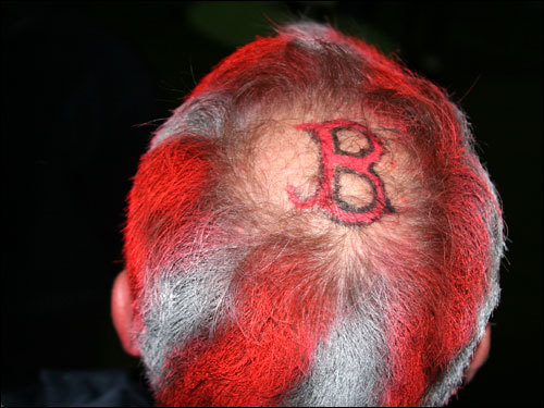 Mike Nelson, from Newton, found himself with a head full of red stripes and a Red Sox tattoo after he decided to to attend face-painting day at his daughter's school Saturday afternoon.