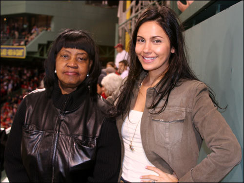 Onelcida Ramirez (left) the mother of Red Sox outfielder Manny Ramirez, took in the game from on top of the Monster with Juliana Ramirez, wife of the all-time postseason home run leader. 'He's so happy right now,' Juliana said of her hot-hitting husband.