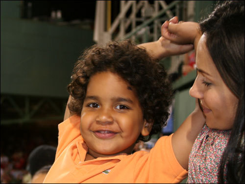 Manny Jr. has a way to go before his hair reaches the length of his father's long locks...