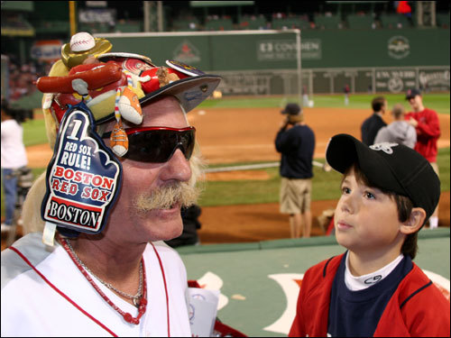 Del 'Dog Man' Christman, the clubhouse manager for the Lowell Spinners, wore his custom-made hat in 2004 when the Sox won the whole thing. 'I'm wearing it again now. It's gonna bring good luck, Christman said.