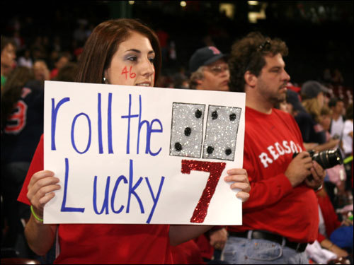 Lyndi Savastano, from Salem, N.H., found out she was going to the game on Sunday morning. So she made a 'Lucky 7' sign to bring the Sox some good luck.