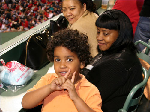 Manny Jr.'s still working on his home run sky point, but Manny's mom and Jr.'s grandmother Onelcida (center) is pleased.
