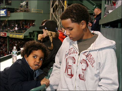 Four-year old Manny Ramirez Jr. climbed up on his stool in the Monster seats while his brother, 13-year-old Manuel O'Neil Ramirez looked on during Game 1 of the World Series Wednesday night at Fenway Park.