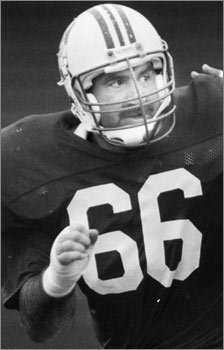 Look beneath the helmet and you'll see former Patriots lineman Fred Smerlas sporting a thick mustache in this 1991 photo. <!-- // define variables var date = new Date(); var current_time = date.getTime(); // write SCRIPT tag to browser document.writeln(' '); // -->