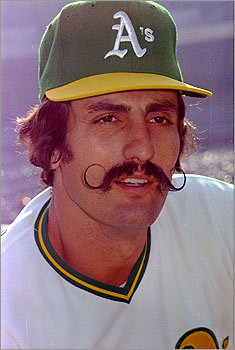 Oakland A's relief pitcher Rollie Fingers may have spent as much time waxing his curly mustache as he did fine-tuning his curveball. Either way, neither passion got in the way of the other, as he's shown here at the 1973 World Series. <!-- // define variables var date = new Date(); var current_time = date.getTime(); // write SCRIPT tag to browser document.writeln(' '); // -->