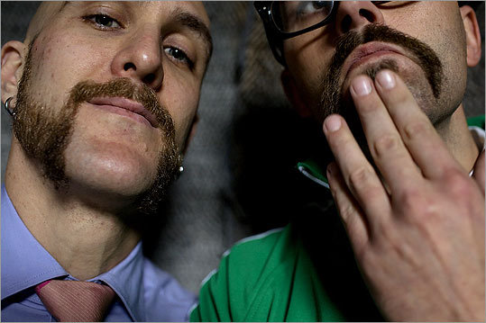 Local mustache fans Cyrille Conan (right) and Mike DiMaggio with their mustaches at A Street Frames in Cambridge.