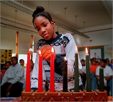 The candle-lighting ceremony is an integral part of the community aspect of Kwanzaa. Each of the seven candles in the kinara represents one of the principles of the holiday: unity, self-determination, collective work and responsibility, collective economics, purpose, creativity, and faith.