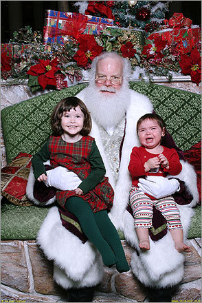 Kelly and Emma, of Wilmington pay Santa a visit. Aunt Colleen says, 'Miss Kelly is captivated by the magic of Christmas and enjoyed visiting Santa while her little sister wasn't so sure about the big man in the red suit.'