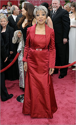 Ruby Dee shows that red is ageless, especially in stunning satin Kevan Hall creation.
