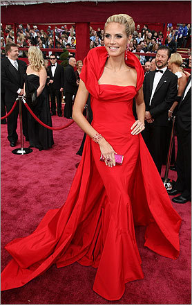 Wearing a custom John Galliano gown, 'Project Runway' host Heidi Klum cut an elegant figure with Grace Kelly hair and jewels.