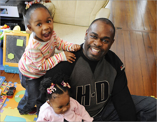 Bryant Hollins, with daughters Jada and Laila, says shows about millionaire fathers such as rappers Rev. Run and Snoop Dogg don't represent the typical African-American family.