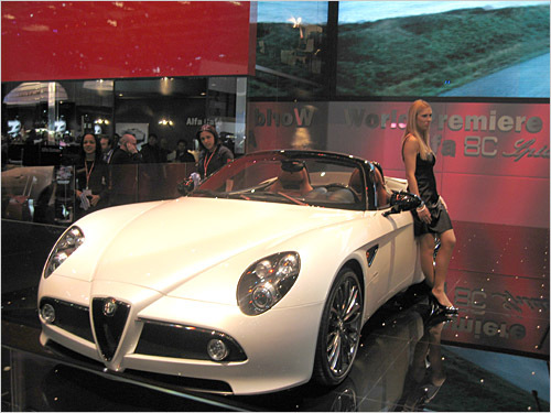 Alfa Romeo 8C Spider The highs: Perhaps the most stunningly original styling in exotic cars today, it simply exudes sex appeal. The lows: The stylish women never left the cars, so I couldn't get into the driver's seat. (Clifford Atiyeh / Boston.com)
