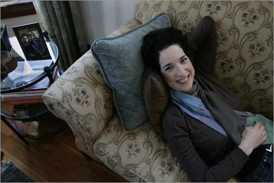 Abbey Koplovitz, interior designer, relaxes on her Treadwell sofa from the Lillian August Collection at Drexel Heritage.