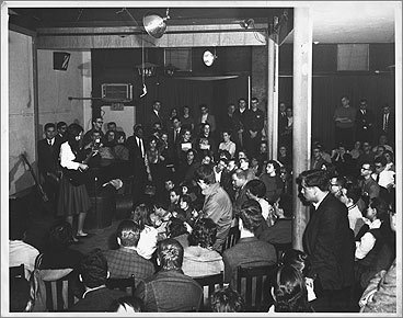Joan Baez performs in the former Club 47. This is one of the few photos from that era that gives a fairly good glimpse at the stage and its surroundings. Club 47 opened its doors on Jan. 6, 1958, at 47 Mt. Auburn St.
