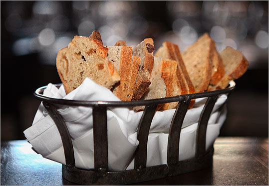 A Sel de Terre breadbasket contains fig-anise, multigrain, sourdough, pumpernickel, and rye.