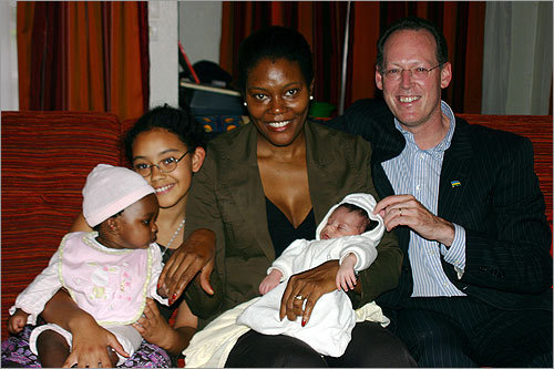 The Farmer family in an Easter photo in Kigali. From left: Elizabeth (6 months); Catherine (10), Didi Bertrand, baby Sebastian and Paul Farmer.