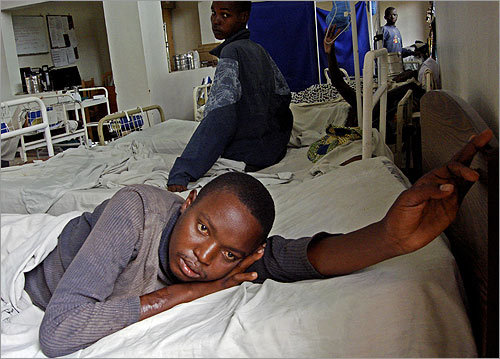 In an adult ward at Rwinkwavu Hospital. The main diseases treated here are malaria, tuberculosis and HIV/AIDS.