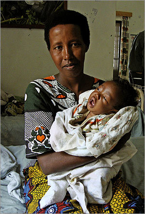 Mother and baby in malnutrition ward at Rwinkwavu Hospital, run by Partners In Health/Inshuti Mu Buzima in eastern Rwanda.