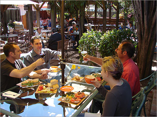 At the Sunflower Caffe, the back patio offers a happy hour alternative of lamb burgers, oysters, and wines and cheeses.