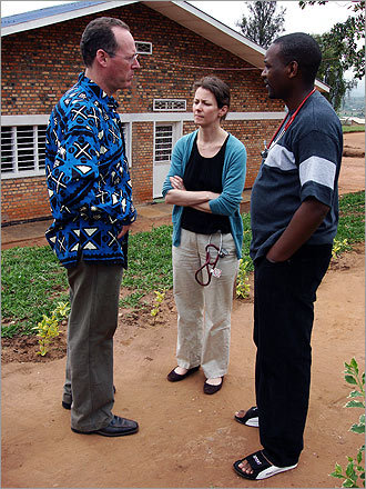 Doctors Paul Farmer, Deborah Jones, and Blaise Bucyibaruta confer just after the death of an AIDS patient at Rwinkwavu Hospital. Jones was a visiting doctor from New York.