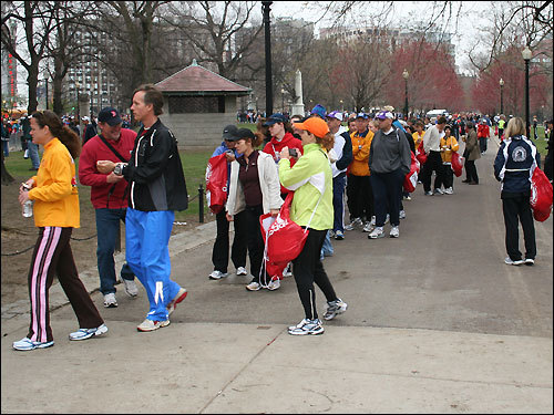 Runners lined up on Boston Common and waited patiently to board the buses.
