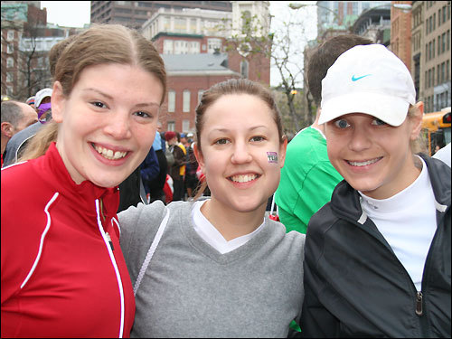 Tara Reed, 25, and Amy Bensle, 28, both of Brighton, are running their first marathon today. They bumped into their friend Eissa Shively, 27, of New York City, in line for the buses. Shively started racing at an early age; she's running her 15th marathon today. All three woman are running with Team In Training for the Leukemia & Lymphoma Society.