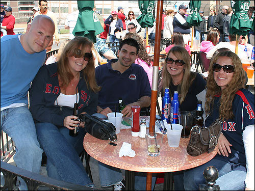 José Bartell, 35, of Quincy; Tracey Sharp, 28, of Boston; Andy Fadous, 28, of Brighton; Jenn Altomare, 29, of South Boston; and Shawna Lenz, 28, of South Boston got to the Cask 'n Flagon at 8:30 this morning to secure a table in the sunshine. Spending Marathon day here is a tradition of Tracey's from her days as a student at BU, but they'll all wander down to the race later on to cheer on their friends who are running.
