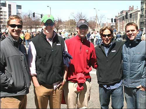 Quinn Veysey, 29, and Brian Pienciak, 25, both of Greenwich, Conn.; Cameron Gammill, 29, of Rowayton, Conn.; Quinn's brother Charles Veysey, 32, of Charlestown; and David Baine, 23, of Manhattan watched the lead runners from their perch in the Fenway bleachers. Then they left the game in the fourth inning to come down to see the rest of the marathoners run through Kenmore Square.