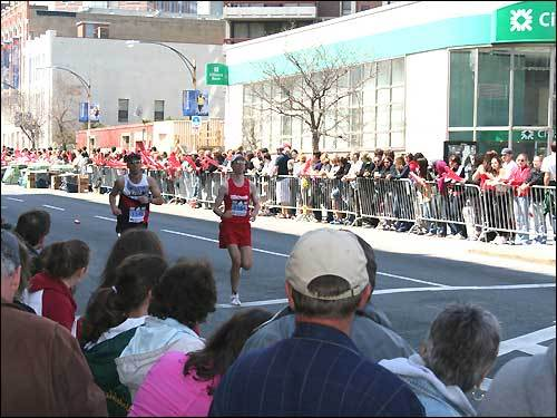 Elite runners are cheered on by the crowds on Boylston Street.