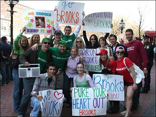 Friends of Aaron Brooks, a third-year Harvard law student from Conway, Ark., ran alongside him blasting inspirational music at Mile Eight, caught up with him again at Kenmore Square to cheer for him at Mile 25, then headed off to see him cross the finish line.